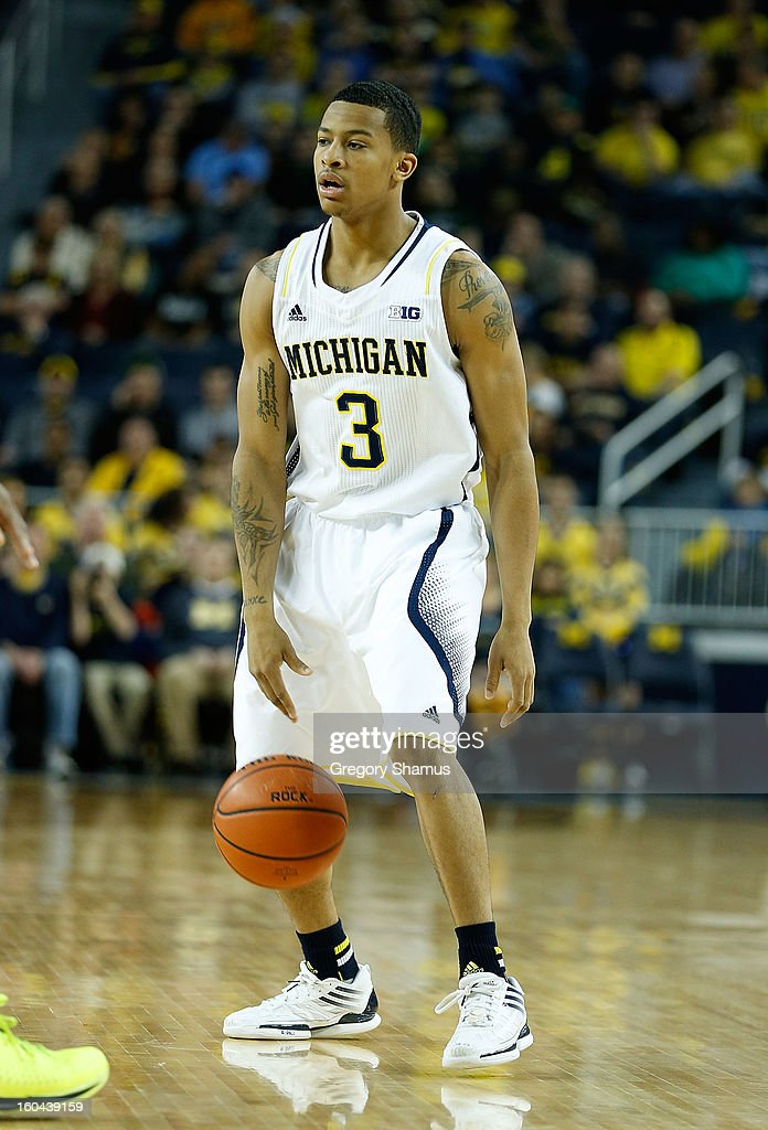 Trey Burke #3 of the Michigan Wolverines dribbles against the Eastern Michigan Eagles at Crisler Center on December 20, 2012 in Ann Arbor, Michigan.