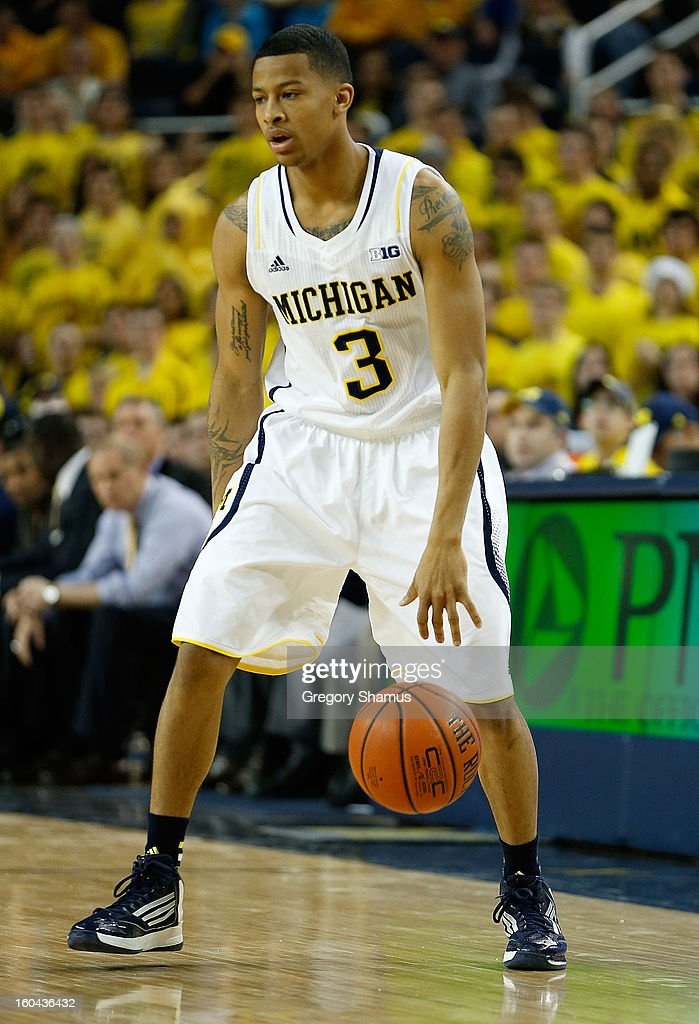 Trey Burke #3 of the Michigan Wolverines dribbles against the Purdue Boilermakers at Crisler Center on January 24, 2013 in Ann Arbor, Michigan. Michigan won the game 68-53.