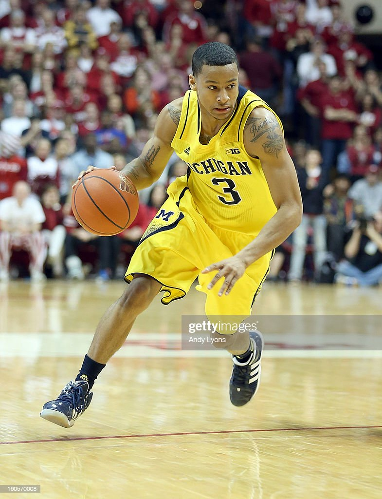 Trey Burke #3 of the Michigan Wolverines dribbles the ball during the game against the Indiana Hoosiers at Assembly Hall on February 2, 2013 in Bloomington, Indiana.
