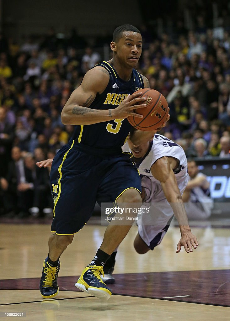Trey Burke #3 of the Michigan Wolverines drives past Jared Swopshire #12 of the Northwestern Wildcats at Welsh-Ryan Arena on January 3, 2013 in Evanston, Illinois. Michigan defeated Northwestern 94-66.