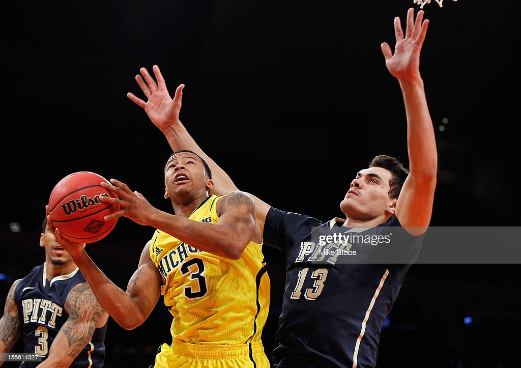 Trey Burke #3 of the Michigan Wolverines drives the ball towards the net against Steven Adams #13 of the Pittsburgh Panthers during the NIT Season Tip-Off at Madison Square Garden on November 21, 2012 in New York City. Michigan defeated Pittsburgh 67-62.
