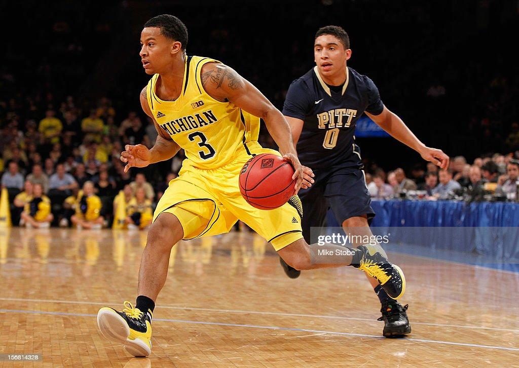 Trey Burke #3 of the Michigan Wolverines drives the ball towards the net against James Robinson #0 of the Pittsburgh Panthers during the NIT Season Tip-Off at Madison Square Garden on November 21, 2012 in New York City. Michigan defeated Pittsburgh 67-62.