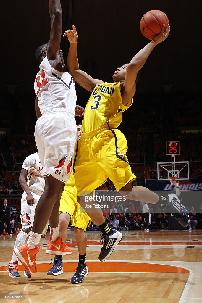 Trey Burke #3 of the Michigan Wolverines drives to the basket against Nnanna Egwu #32 of the Illinois Fighting Illini during the game at Assembly Hall on January 27, 2013 in Champaign, Illinois. Michigan defeated Illinois 74-60.