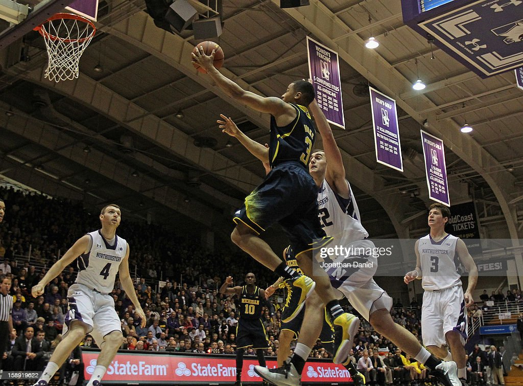 Trey Burke #3 of the Michigan Wolverines drives to the basket past Alex Olah #22 of the Northwestern Wildcats at Welsh-Ryan Arena on January 3, 2013 in Evanston, Illinois. Michigan defeated Northwestern 94-66.