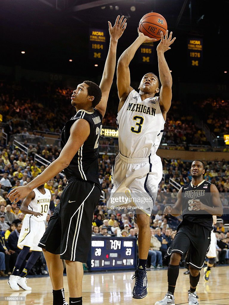 Trey Burke #3 of the Michigan Wolverines gets a first half shot against A.J. Hammons #20 of the Purdue Boilermakers at Crisler Center on January 24, 2013 in Ann Arbor, Michigan.