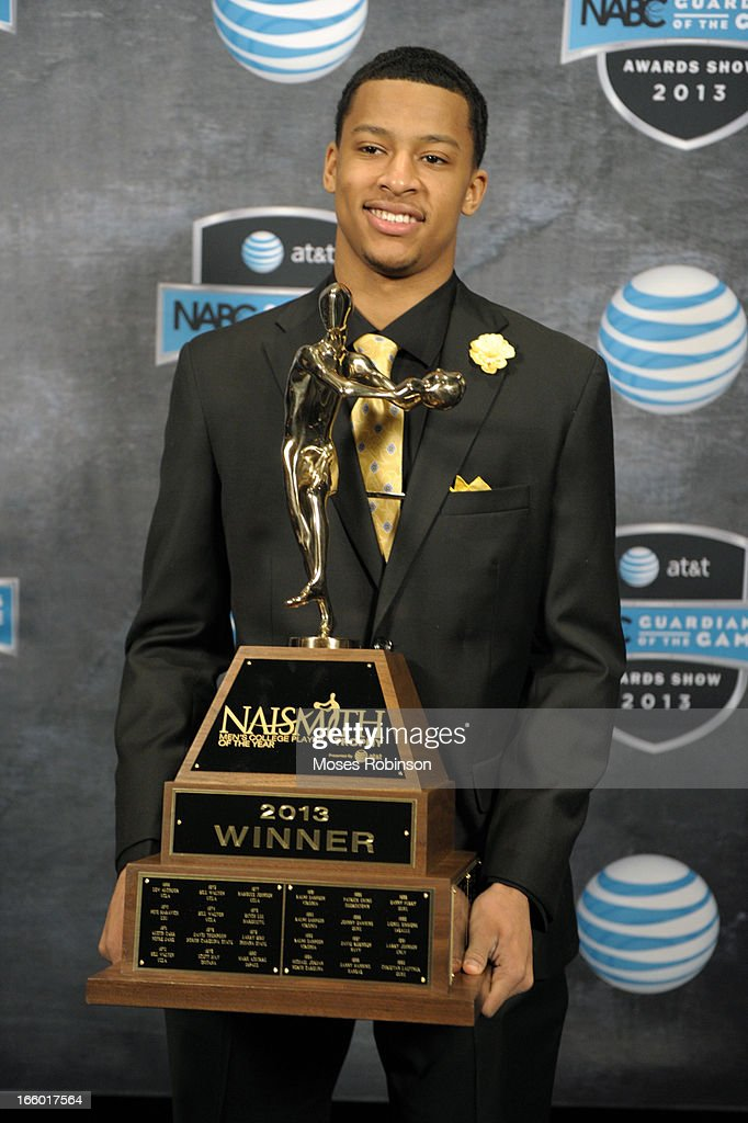 Trey Burke of the Michigan Wolverines poses with the 2013 Naismith Trophy at the NABC Guardians of the Game Awarding of the Naismith Trophy Presented by AT&T at Georgia World Congress Center on April 7, 2013 in Atlanta, Georgia.