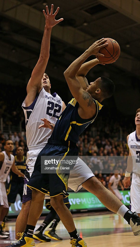 Trey Burke #3 of the Michigan Wolverines shoots against Alex Olah #22 of the Northwestern Wildcats at Welsh-Ryan Arena on January 3, 2013 in Evanston, Illinois. Michigan defeated Northwestern 94-66.