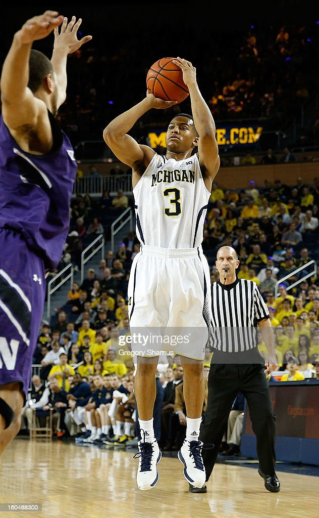 Trey Burke #3 of the Michigan Wolverines takes a jump shot against the Northwestern Wildcats at Crisler Center on January 30, 2013 in Ann Arbor, Michigan.