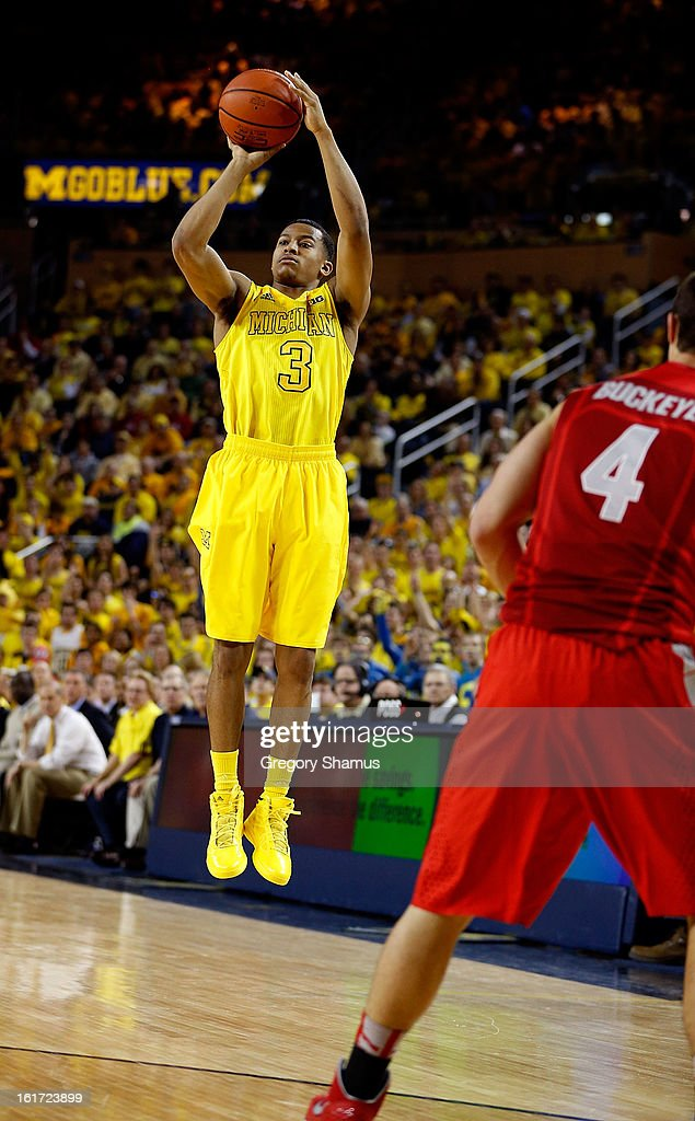 Trey Burke #3 of the Michigan Wolverines takes a jumper against the Ohio State Buckeyes at Crisler Center on February 5, 2013 in Ann Arbor, Michigan. Michigan won the game 76-74 in overtime.