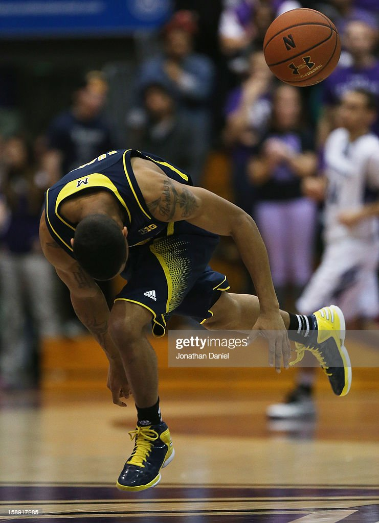 Trey Burke #3 of the Michigan Wolverines tries to chase down a loose ball against the Northwestern Wildcats at Welsh-Ryan Arena on January 3, 2013 in Evanston, Illinois.