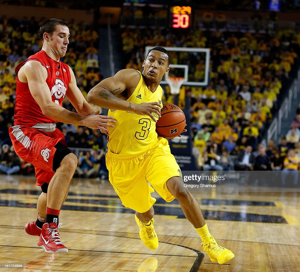 Trey Burke #3 of the Michigan Wolverines tries to get past Aaron Craft #4 of the Ohio State Buckeyes at Crisler Center on February 5, 2013 in Ann Arbor, Michigan. Michigan won the game 76-74 in overtime.