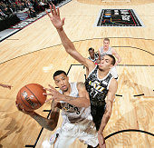 Trey Burke of the US Team goes up to shoot against Rudy Gobert of the World Team during the BBVA Compass Rising Stars Challenge as part of 2015...