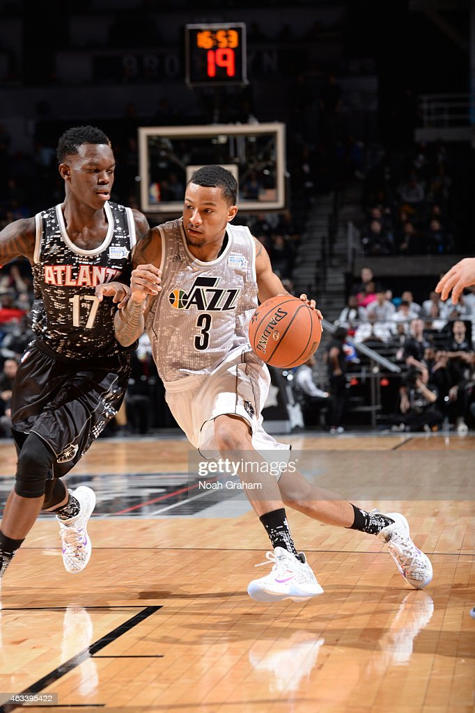 Trey Burke #3 of the USA team drives against Dennis Schroder #17 of the World team in the 2015 BBVA Rising Stars Challenge on February 13, 2015 at Barclays Center in Brooklyn, New York.