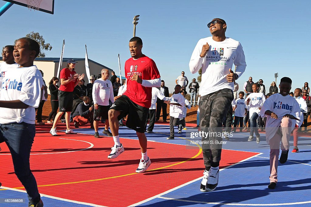Trey Burke #3 of the Utah Jazz and Bradley Beal #3 of the Washington Wizards run up court during the Boys & Girls Club of Protea Glen court dedication as part the Basketball Without Boarders program on July 30, 2015 at the Protea Glen Clubhouse in Soweto, South Africa.