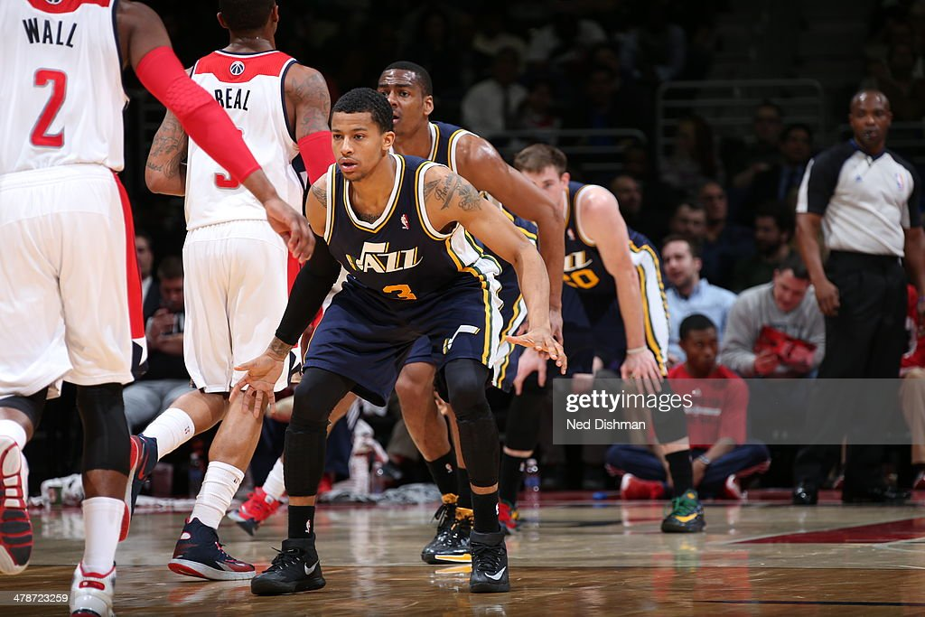 <a gi-track='captionPersonalityLinkClicked' href=/galleries/search?phrase=Trey+Burke&family=editorial&specificpeople=8770717 ng-click='$event.stopPropagation()'>Trey Burke</a> #3 of the Utah Jazz defends against the Washington Wizards at the Verizon Center on March 5, 2014 in Washington, DC.