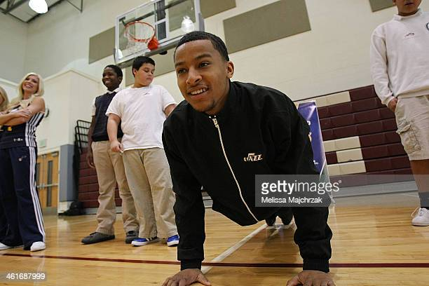 Trey Burke of the Utah Jazz does pushups during a clinic showing students how to get fit at Glendale Middle School on January 08 2014 in Salt Lake...