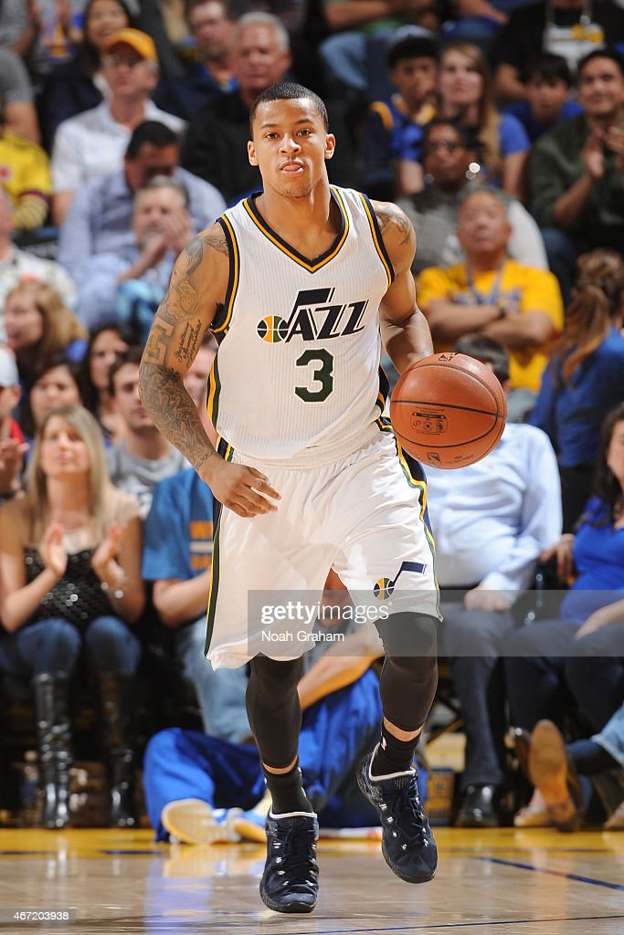 Trey Burke #3 of the Utah Jazz dribbles against the Golden State Warriors on March 21, 2015 at Oracle Arena in Oakland, California.