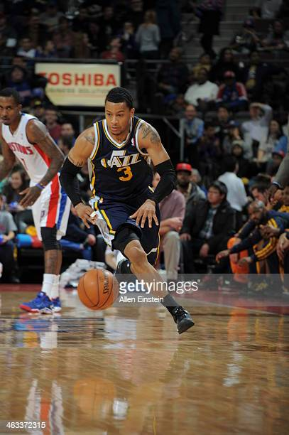Trey Burke of the Utah Jazz dribbles the ball against the Detroit Pistons during the game on January 17 2014 at The Palace of Auburn Hills in Auburn...
