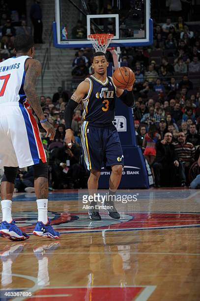 Trey Burke of the Utah Jazz dribbles up the court against the Detroit Pistons during the game on January 17 2014 at The Palace of Auburn Hills in...