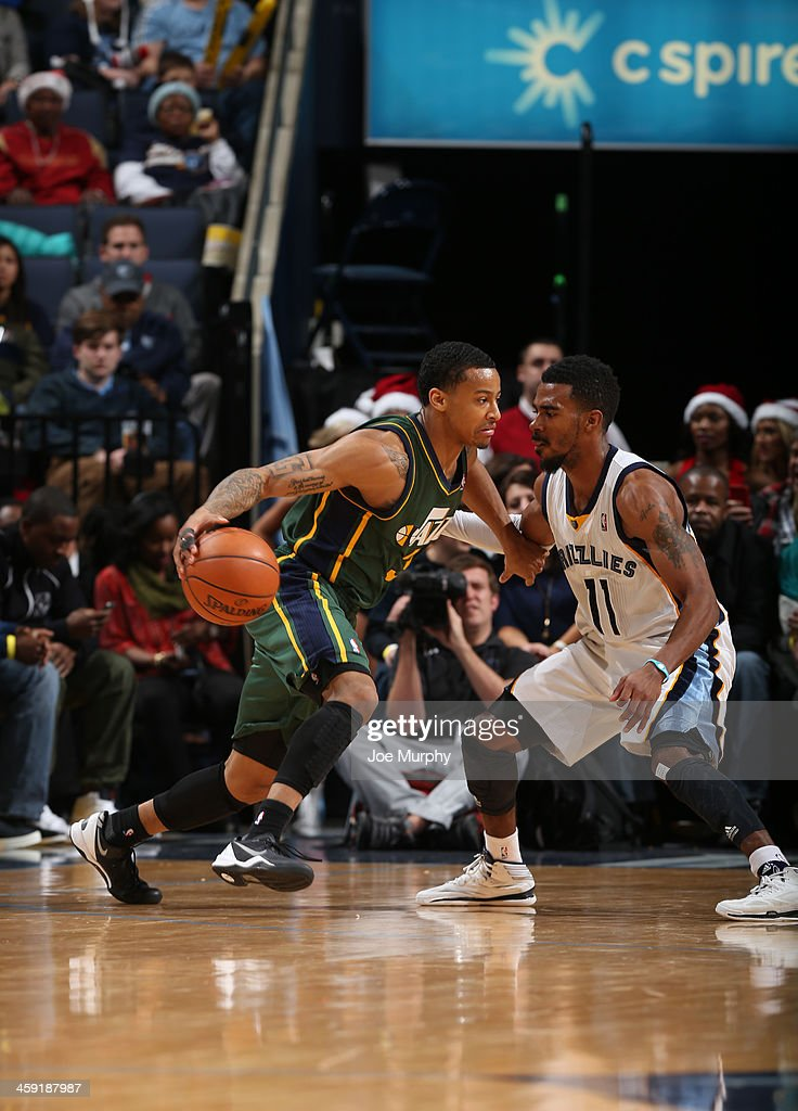 <a gi-track='captionPersonalityLinkClicked' href=/galleries/search?phrase=Trey+Burke&family=editorial&specificpeople=8770717 ng-click='$event.stopPropagation()'>Trey Burke</a> #3 of the Utah Jazz drives against the Memphis Grizzlies on December 23, 2013 at FedExForum in Memphis, Tennessee.
