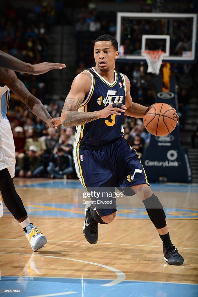 <a gi-track='captionPersonalityLinkClicked' href=/galleries/search?phrase=Trey+Burke&family=editorial&specificpeople=8770717 ng-click='$event.stopPropagation()'>Trey Burke</a> #3 of the Utah Jazz drives to the basket against the Denver Nuggets on December 13, 2013 at the Pepsi Center in Denver, Colorado.
