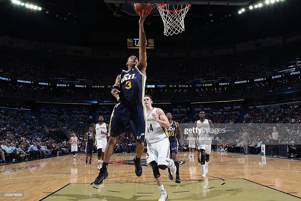 <a gi-track='captionPersonalityLinkClicked' href=/galleries/search?phrase=Trey+Burke&family=editorial&specificpeople=8770717 ng-click='$event.stopPropagation()'>Trey Burke</a> #3 of the Utah Jazz drives to the basket against the New Orleans Pelicans on November 20, 2013 at the New Orleans Arena in New Orleans, Louisiana.
