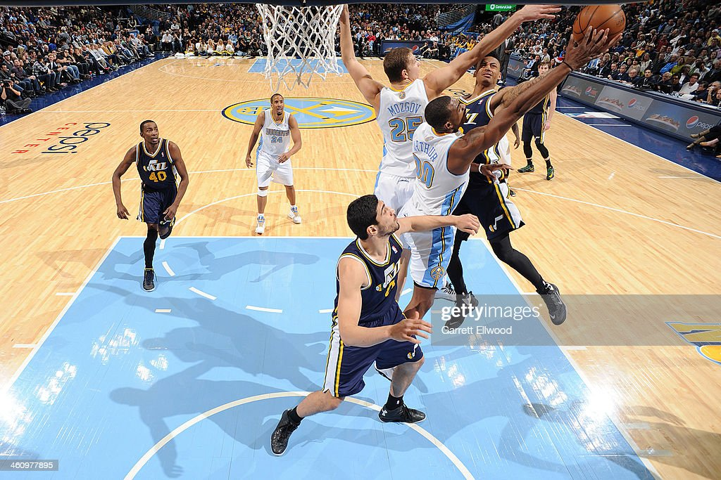 <a gi-track='captionPersonalityLinkClicked' href=/galleries/search?phrase=Trey+Burke&family=editorial&specificpeople=8770717 ng-click='$event.stopPropagation()'>Trey Burke</a> #3 of the Utah Jazz drives to the basket through traffic against the Denver Nuggets on December 13, 2013 at the Pepsi Center in Denver, Colorado.