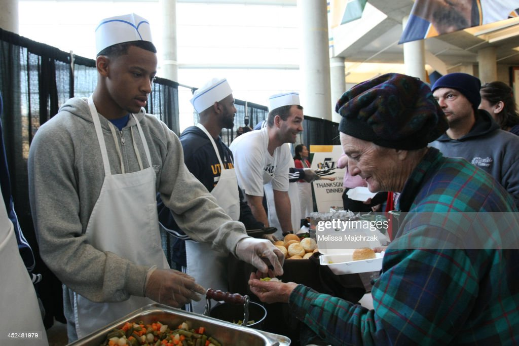 Trey Burke #3 of the Utah Jazz during hands out food during the we care-we share Thanksgiving Dinner feeding the homeless at EnergySolutions Arena on November 27, 2013 in Salt Lake City, Utah.