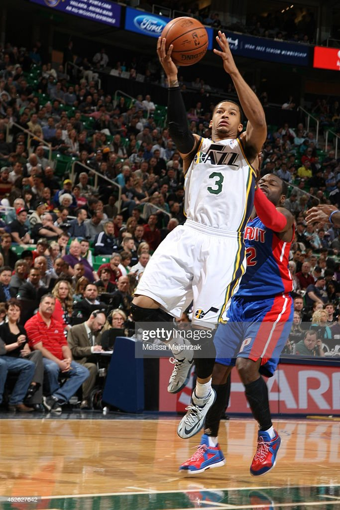 <a gi-track='captionPersonalityLinkClicked' href=/galleries/search?phrase=Trey+Burke&family=editorial&specificpeople=8770717 ng-click='$event.stopPropagation()'>Trey Burke</a> #3 of the Utah Jazz goes up for a shot against the Detroit Pistons at EnergySolutions Arena on March 24, 2014 in Salt Lake City, Utah.
