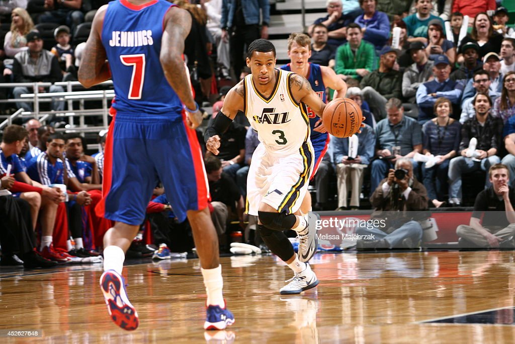<a gi-track='captionPersonalityLinkClicked' href=/galleries/search?phrase=Trey+Burke&family=editorial&specificpeople=8770717 ng-click='$event.stopPropagation()'>Trey Burke</a> #3 of the Utah Jazz handles the ball against the Detroit Pistons at EnergySolutions Arena on March 24, 2014 in Salt Lake City, Utah.