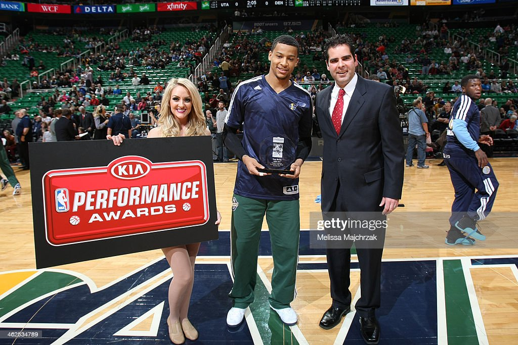 Trey Burke #3 of the Utah Jazz is presented the Kia Rookie of the Month award by Joe Oppedisano and displays it proudly before his matchup against the Denver Nuggets at EnergySolutions Arena on January 13, 2014 in Salt Lake City, Utah.