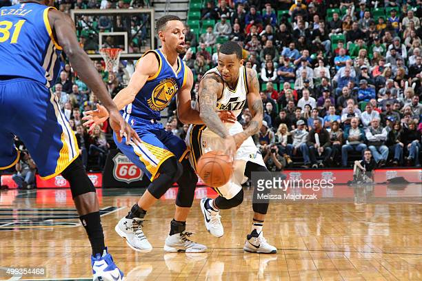 Trey Burke of the Utah Jazz passes the ball during the game against the Golden State Warriors on November 30 2015 at EnergySolutions Arena in Salt...