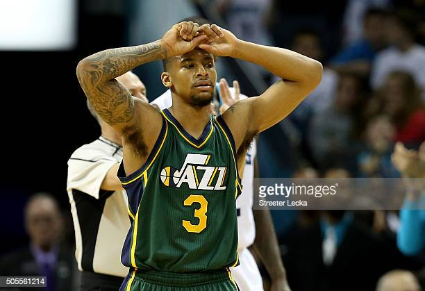 Trey Burke of the Utah Jazz reacts after a play during their game against the Charlotte Hornets at Time Warner Cable Arena on January 18 2016 in...