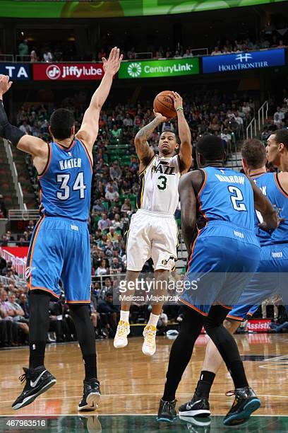 Trey Burke of the Utah Jazz shoots against Enes Kanter of the Oklahoma City Thunder on March 28 2015 at EnergySolutions Arena in Salt Lake City Utah...