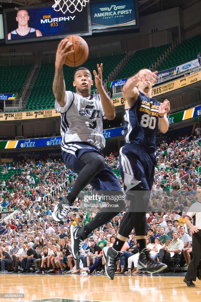 Trey Burke #3 of the Utah Jazz shoots against Jason Washburn #80 during an open scrimmage at Energy Solutions Arena on July 8, 2014 in Salt Lake City, Utah.