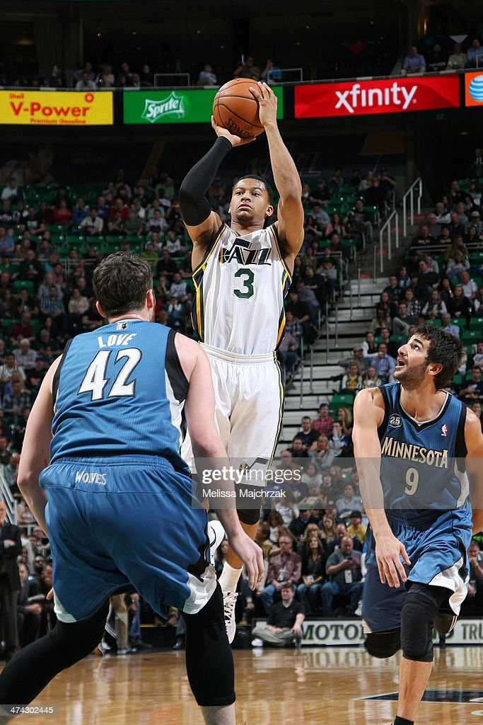 <a gi-track='captionPersonalityLinkClicked' href=/galleries/search?phrase=Trey+Burke&family=editorial&specificpeople=8770717 ng-click='$event.stopPropagation()'>Trey Burke</a> #3 of the Utah Jazz shoots against <a gi-track='captionPersonalityLinkClicked' href=/galleries/search?phrase=Kevin+Love&family=editorial&specificpeople=4212726 ng-click='$event.stopPropagation()'>Kevin Love</a> #42 of the Minnesota Timberwolves at EnergySolutions Arena on February 22, 2014 in Salt Lake City, Utah.