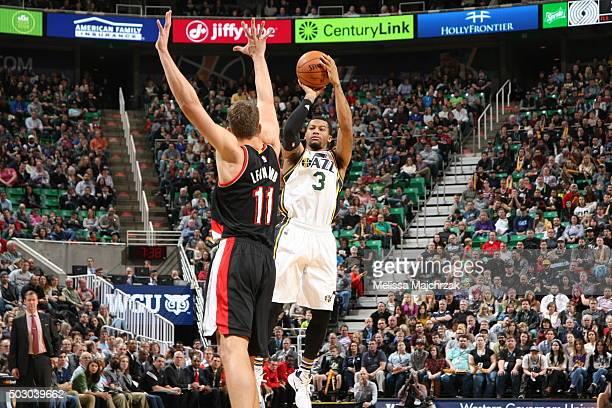 Trey Burke of the Utah Jazz shoots against Meyers Leonard of the Portland Trail Blazers on December 31 2015 at vivintSmartHome Arena in Salt Lake...