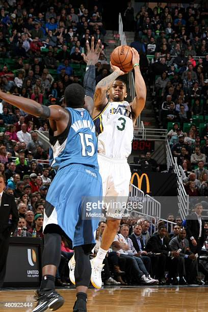 Trey Burke of the Utah Jazz shoots against the Minnesota Timberwolves at EnergySolutions Arena on December 30 2014 in Salt Lake City Utah NOTE TO...