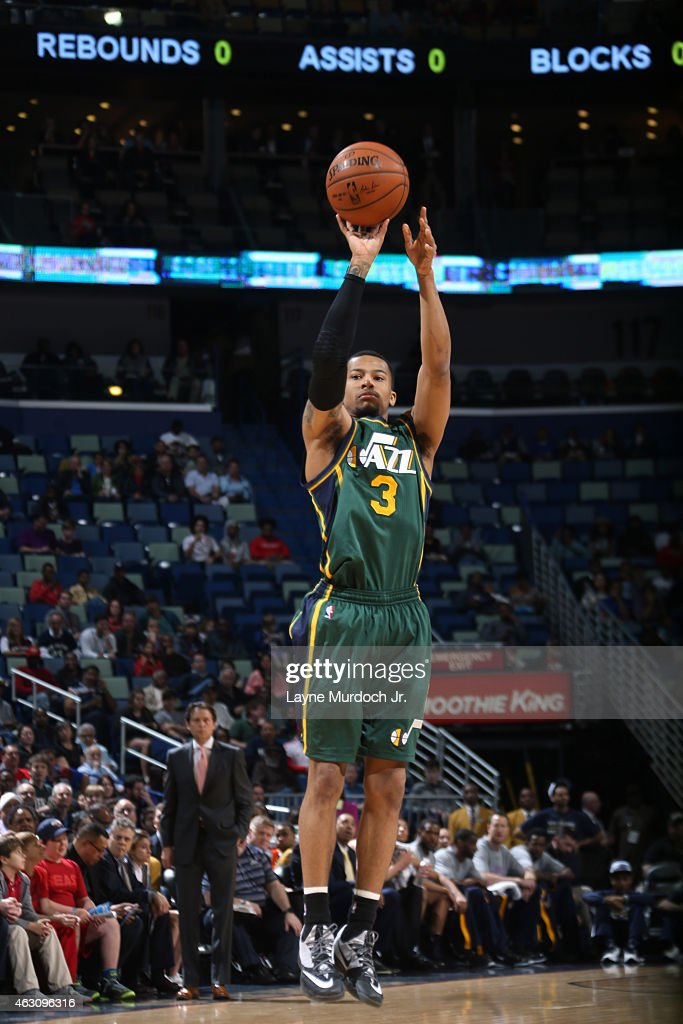 Trey Burke #3 of the Utah Jazz shoots against the New Orleans Pelicans on February 9, 2015 at the Smoothie King Center in New Orleans, Louisiana.