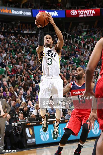 Trey Burke of the Utah Jazz shoots the ball against the Washington Wizards on March 10 2016 at vivintSmartHome Arena in Salt Lake City Utah NOTE TO...