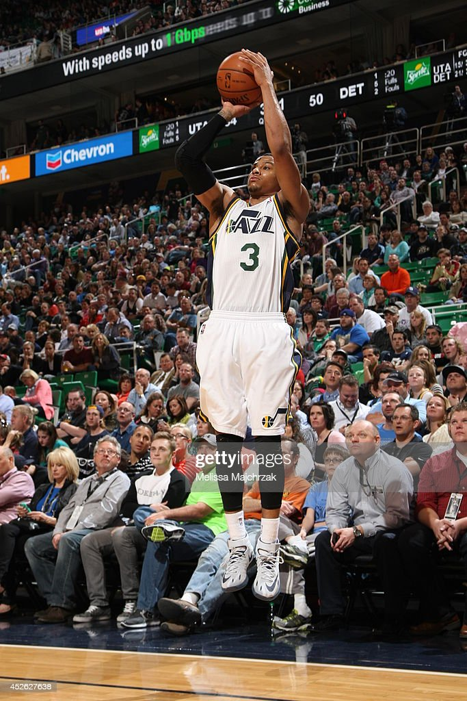 <a gi-track='captionPersonalityLinkClicked' href=/galleries/search?phrase=Trey+Burke&family=editorial&specificpeople=8770717 ng-click='$event.stopPropagation()'>Trey Burke</a> #3 of the Utah Jazz takes a shot against the Detroit Pistons at EnergySolutions Arena on March 24, 2014 in Salt Lake City, Utah.