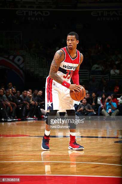 Trey Burke of the Washington Wizards handles the ball against the Miami Heat during a preseason game on October 4 2016 at Verizon Center in...