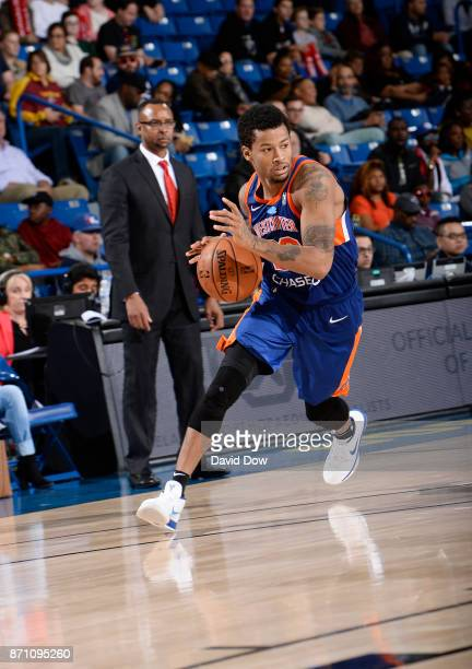 Trey Burke of the Westchester Knicks dribbles against the Delaware 87ers during the game at the Bob Carpenter Center in Newark Delaware on November...