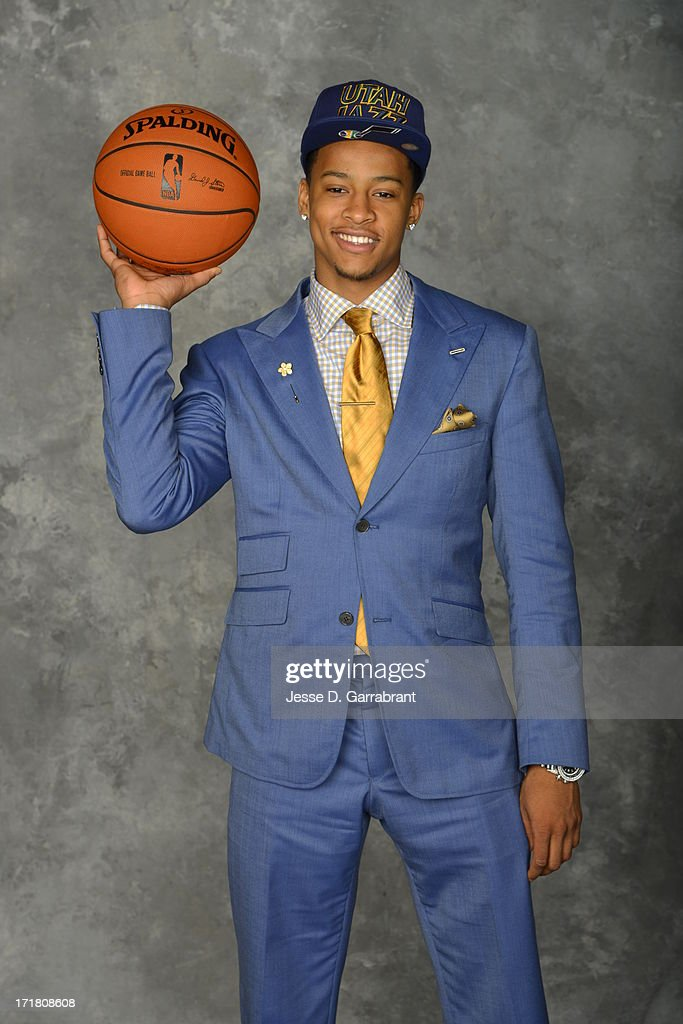 Trey Burke poses for a portrait after being selected during the 2013 NBA Draft at the Barclays Center on June 27, 2013 in Brooklyn, New York.
