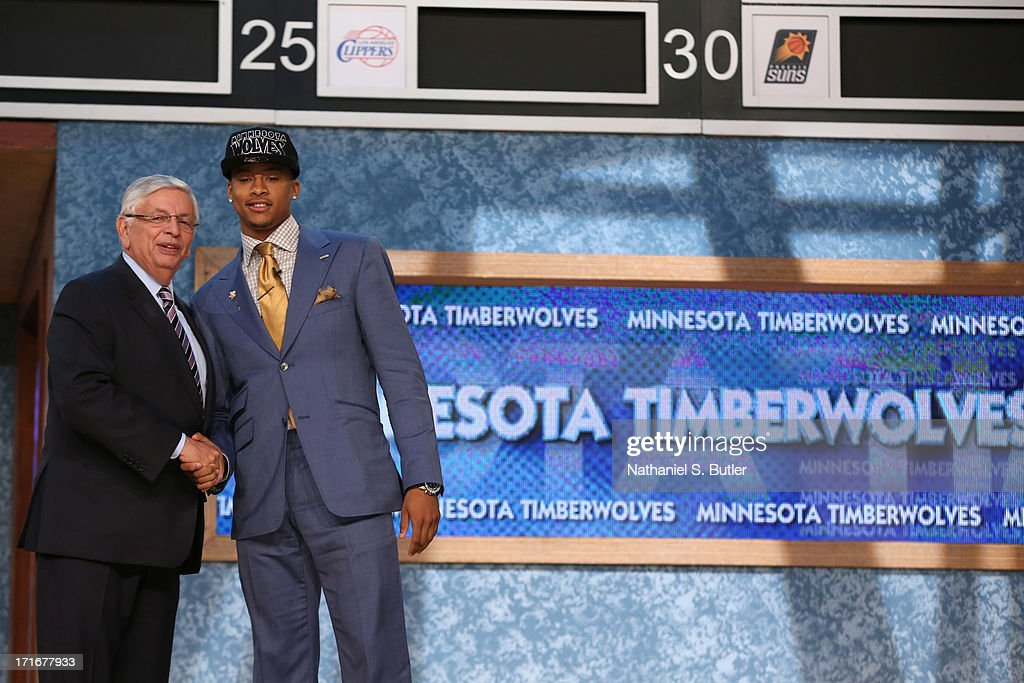 Trey Burke shakes hands with NBA Commissioner, David Stern after being selected number nine overall by the Minnesota Timberwolves during the 2013 NBA Draft on June 27, 2013 at Barclays Center in Brooklyn, New York.
