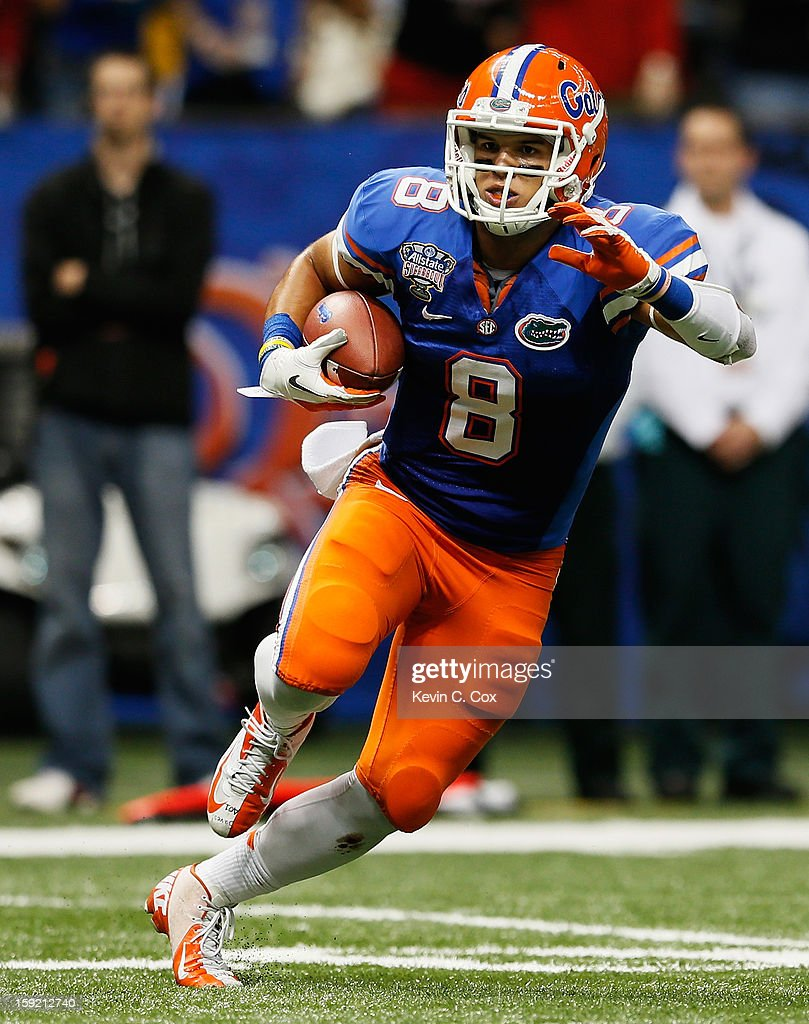 Trey Burton #8 of the Florida Gators carries the ball against the Louisville Cardinals during the Allstate Sugar Bowl at Mercedes-Benz Superdome on January 2, 2013 in New Orleans, Louisiana.