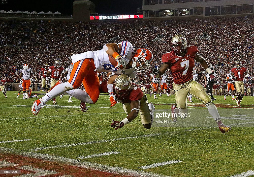Trey Burton #8 of the Florida Gators is forced out of bounds by Terrence Brooks #31 of the Florida State Seminoles during a game at Doak Campbell Stadium on November 24, 2012 in Tallahassee, Florida.