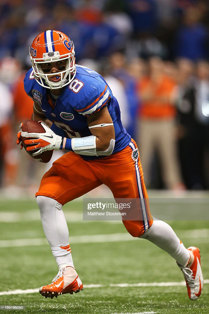 Trey Burton #8 of the Florida Gators scrambles against the Louisville Cardinals during the Allstate Sugar Bowl at Mercedes-Benz Superdome on January 2, 2013 in New Orleans, Louisiana.