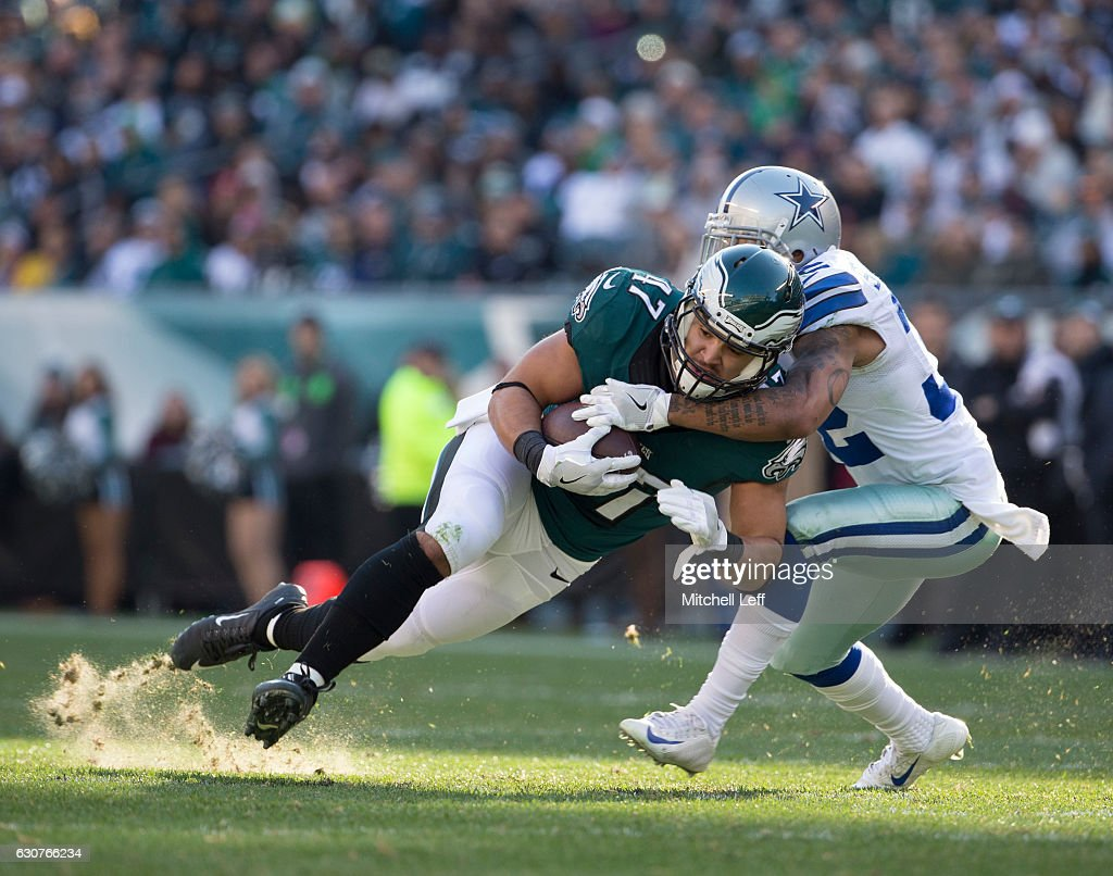 Trey Burton #47 of the Philadelphia Eagles catches a pass and is tackled by Orlando Scandrick #32 of the Dallas Cowboys in the second quarter at Lincoln Financial Field on January 1, 2017 in Philadelphia, Pennsylvania.