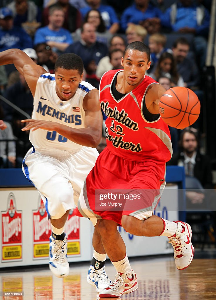 Trey Casey #22 of the CBU Buccaneers dribbles the ball upcourt against Geron Johnson #55 of the Memphis Tigers on November 7, 2012 at FedExForum in Memphis, Tennessee.